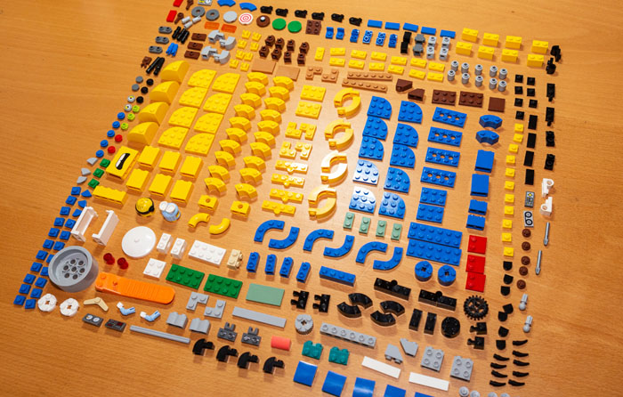 Lego parts laid out in a grid