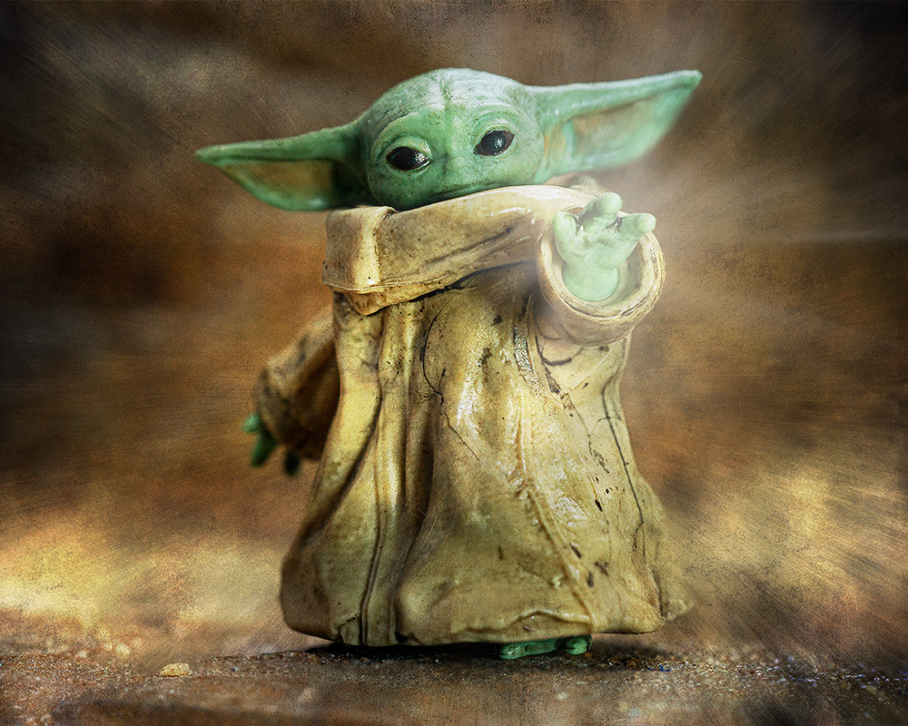 Baby Yoda doing the magic hand thing.
