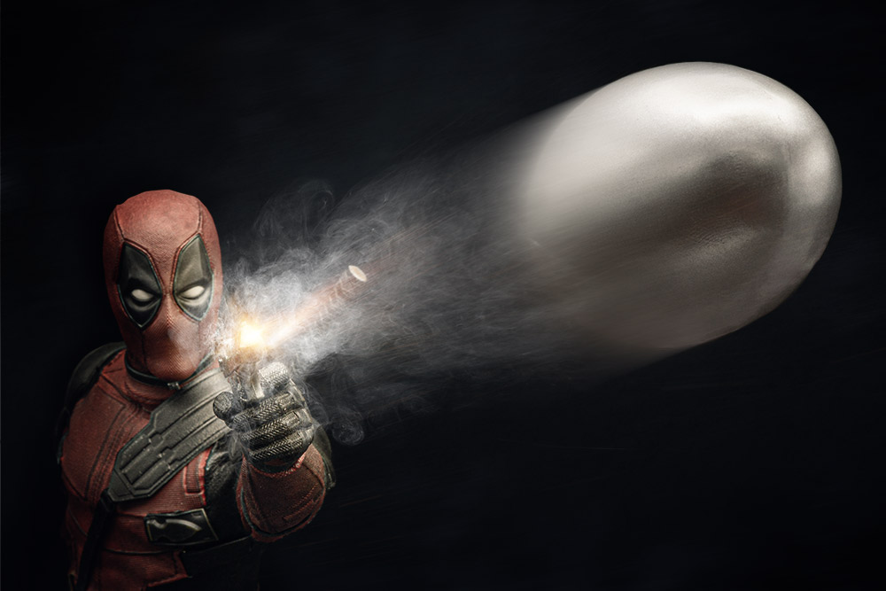 Deadpool shooting a bullet at the camera