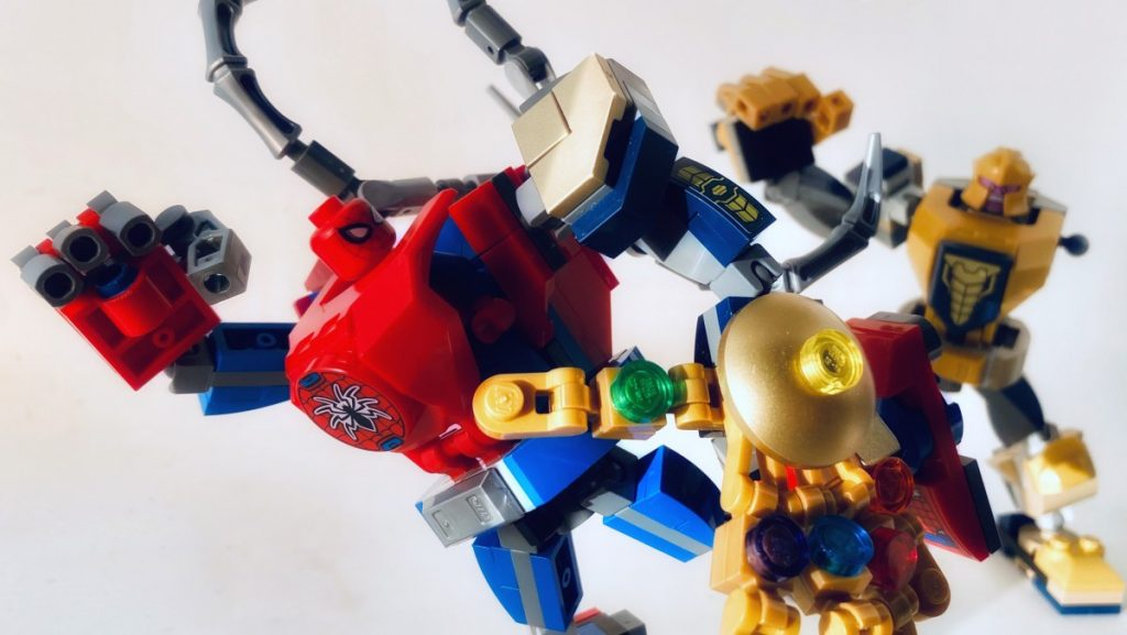 Photo by Adam Ford: LEGO Marvel Super Heroes mech suit Spider-Man has stolen the arm of Thanos's mech suit. Spider-Man and his mech are in the foreground, with Thanos and his mech, which is missing an arm, shaking his fist in anger