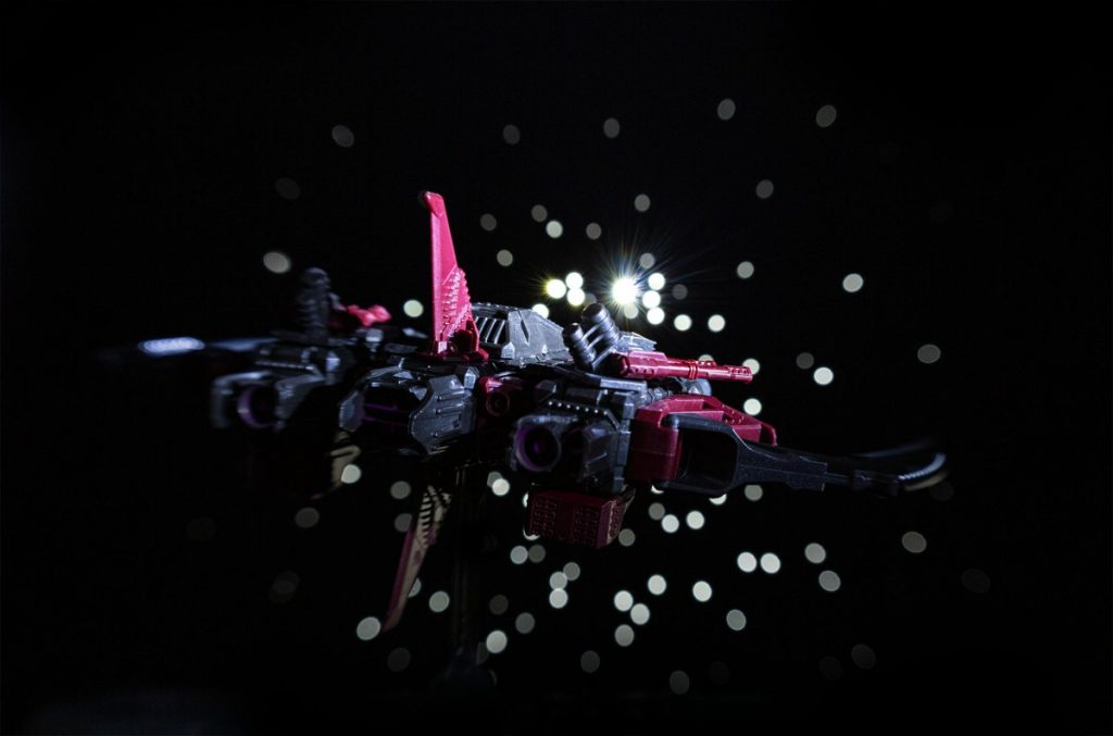 Spaceship flying into starfield.