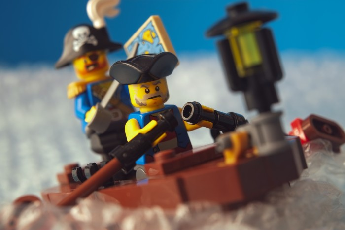 LEGO pirate minifigure rowing on the boat