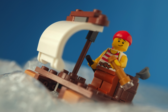 LEGO pirate minifigure on the raft with the sail