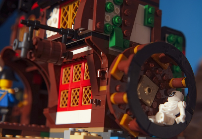 LEGO skeleton lying in the mill wheel