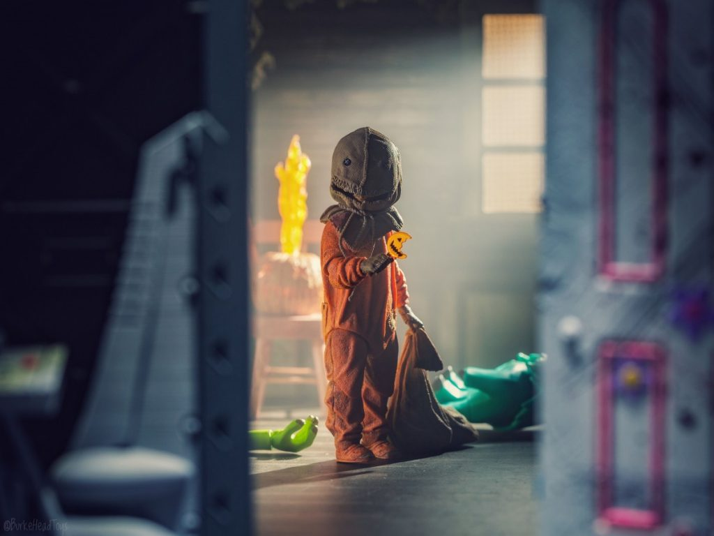 The Wring Door - NECA action figure of Sam from Trick 'r Treat behind the Monsters Inc. door with Mike and Sulley on the ground by Adam Burke, @burkeheadtoys