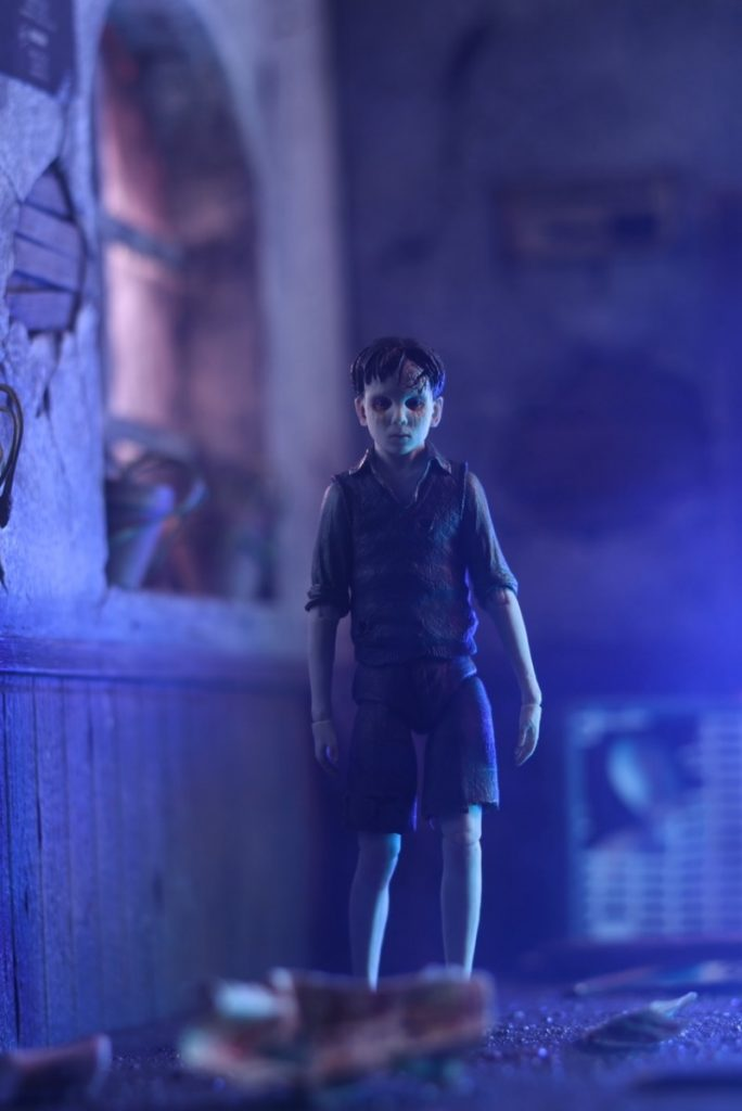 The Devil's Backbone Santi NECA action figure in creepy house by Carlos Mariscal @cmariscal