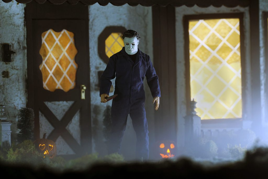 Mezco One:12 Collective Michael Myers action figure in front of large house closer