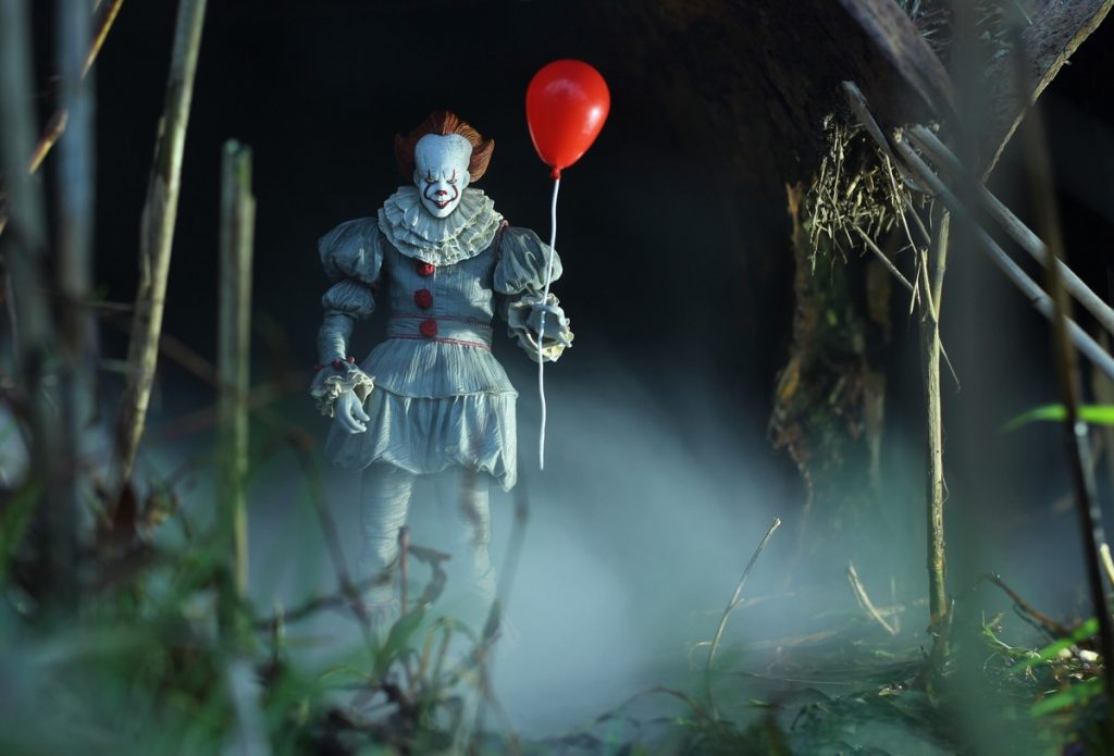 NECA Pennywise action figure with balloon in tunnel
