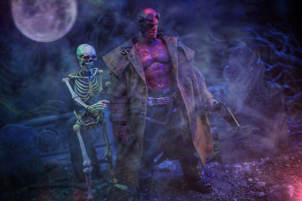 @tromatic_exposure 1:6 scale Hellboy action figure with skeleton in cemetery