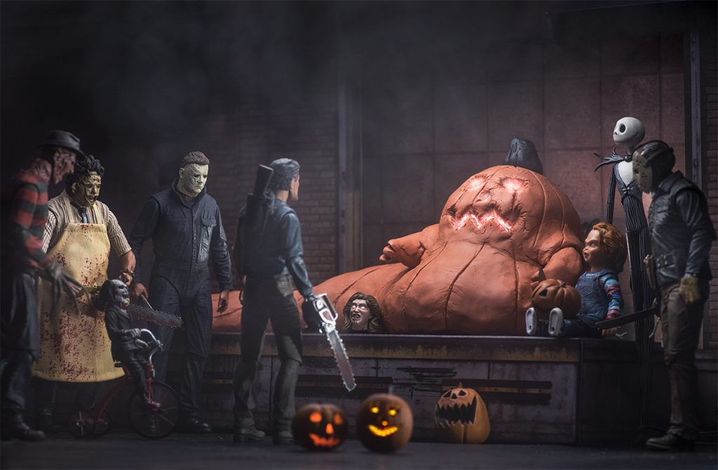Jabba the Hutt as jack-o-lantern surrounded by NECA horror movie slasher action figures by @tuskenmilkbar
