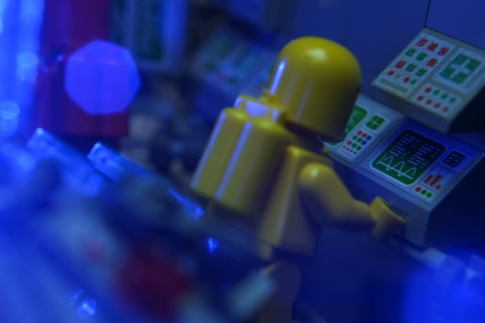 A LEGO built interior of spaceshit with screens and computers