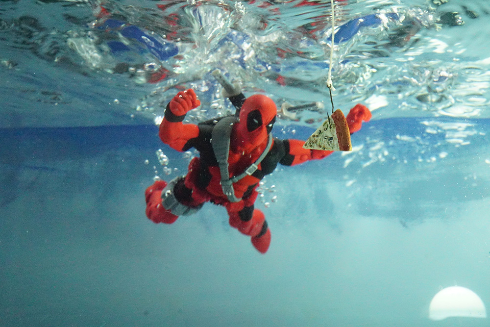 First shot  of dropping Deadpool in a tank of water