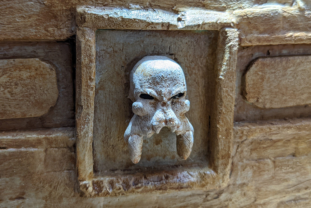 The wall art skull with horns, painted as bone looking, maybe?