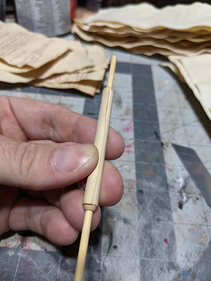 rolling paper into a scroll