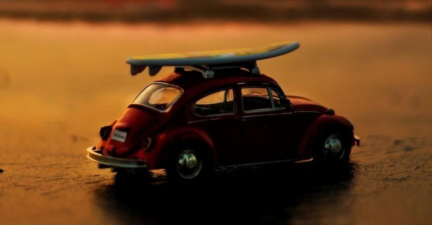 Toy VW Beetle on the beach