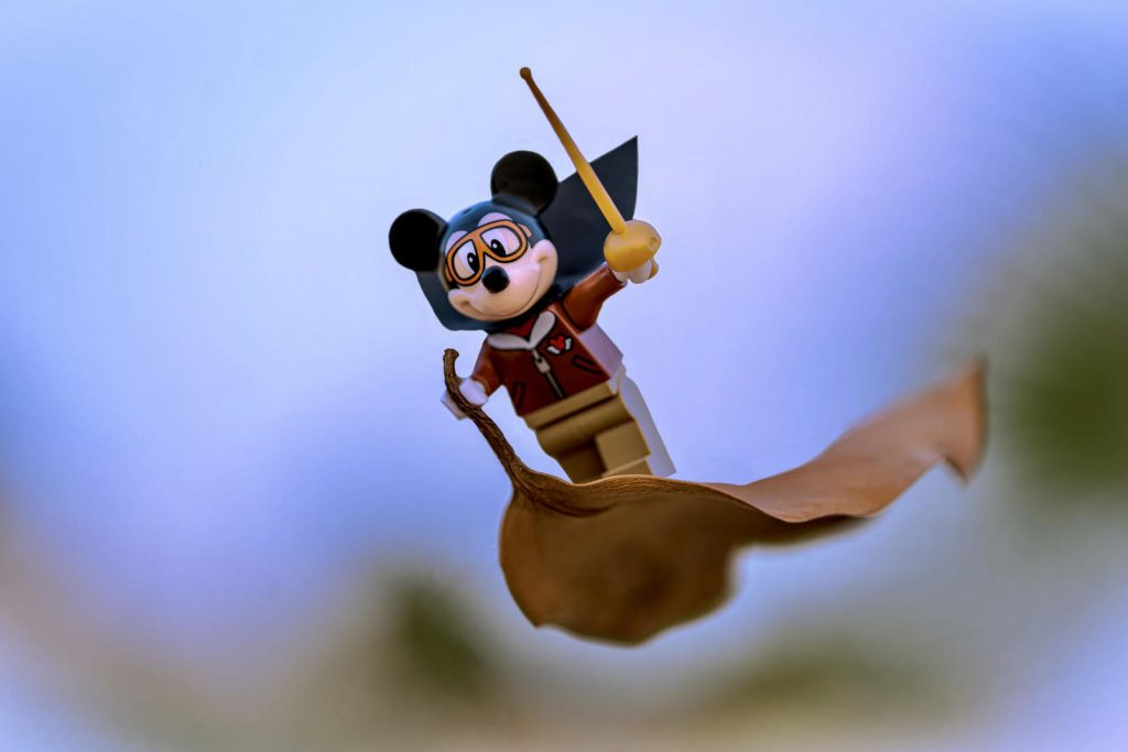 Lego Mickey Mouse pilot minifigure flying on the leaf