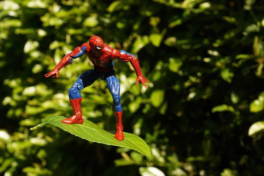 Spiderman action figure surfing on the leaf
