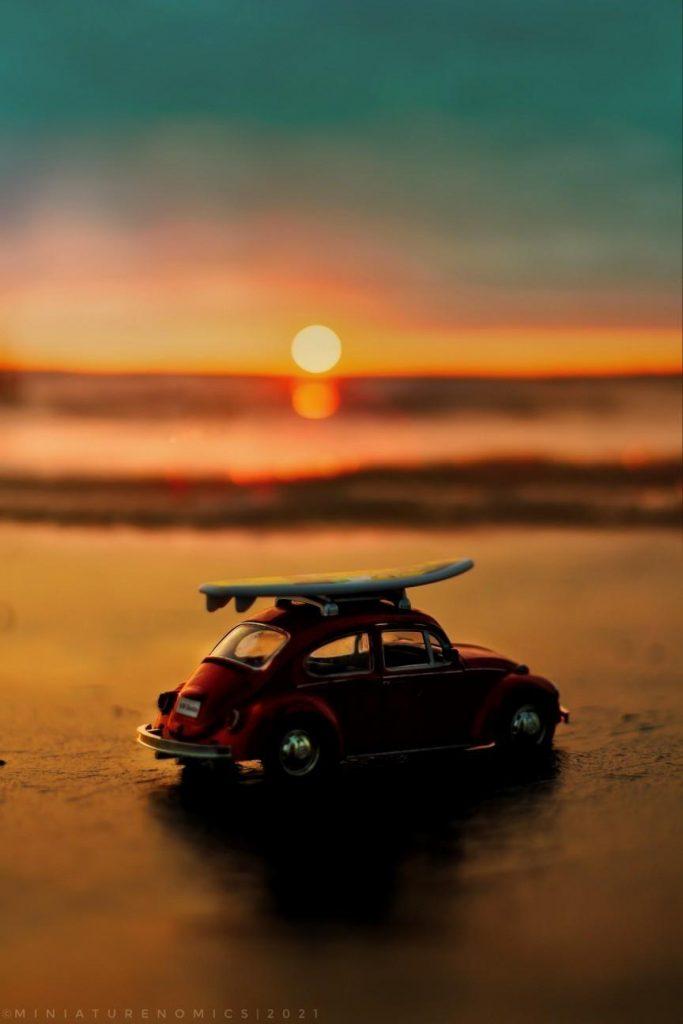 Toy Volkswagen Beetle on the beach