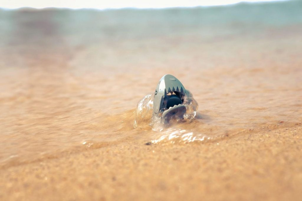 LEGO shark figure emerging from the waves at the beach