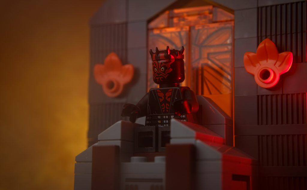 LEGO Darth Maul minifigure sitting on the Mandalore throne