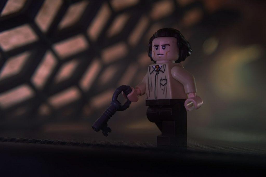 Custom LEGO minifigure of Variant Loki holding a key